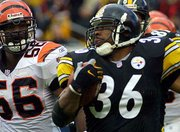 Pittsburgh running back Jerome Bettis (36) runs past Cincinnati's Brian Simmons during the first half of Sunday's game. The Steelers won, 16-7, on a day Bettis passed the 10,000-yard career rushing mark.