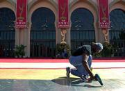 Lee Howard works to remove the red carpet outside the Shrine Auditorium in Los Angeles after an announcement that the ceremony, already delayed three weeks by the Sept. 11 terrorist attacks, was cancelled.