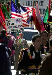 Albert Cabbad, president of the Arab American Parade Committee, leads a float of flags from Arab nations during the Columbus Day Parade in New York. Cabbad, who is from Syria, says an Arab American float has been a part of the parade since 1992.