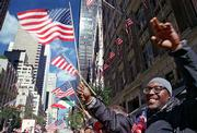 "Sedgwick Barnes, Brooklyn, cheers as a radio broadcast from a float plays Ray Charles&squot; rendition of ""America the Beautiful"" during New York&squot;s annual Columbus Day Parade."