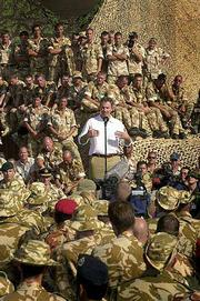 British Prime Minister Tony Blair addresses British troops at a camp in north Oman. Blair is in Oman, a close British ally, on a three-day diplomatic mission to the Mideast region. It's the latest in a series of foreign trips he has made to shore up support for the military action in Afghanistan. In London, police were investigating a threat against Blair.