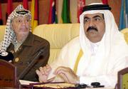 Palestinian leader Yasser Arafat, left, and Emir of Qatar Sheik Hamad bin Khalifa Al Thani listen during the emergency meeting of foreign ministers from the Organization of the Islamic Conference. The meeting Wednesday was called to discuss the U.S. strikes in Afghanistan and the Middle East crisis.