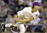 Arizona's Randy johnson delivers a pitch to the St. Louis Cardinals. Johnson entered the postseason with a career-best 21-6 record in the regular season, but he suffered his seventh straight playoff loss a major league record in the Diamondbacks' 4-1 loss Wednesday in Phoenix.