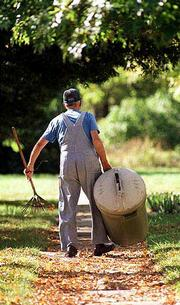 After raking His yard and filling up a trash can with leaves, Bill Puckett calls it a day. Many gardeners use this time of year to tidy up the garden and prepare for next year's growth.