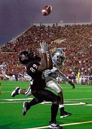Texas Tech's Carlos Francis (82) pulls in a 33-yard reception over Kansas State's DeMarcus Faggins. The Red Raiders stunned the No. 24 Wildcats, 38-19, on Saturday in Lubbock, Texas.