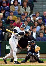 New York's Paul O'Neill hits a two-run homer against Seattle. The Yankees defeated the Mariners on Wednesday at Seattle in Game 1 of the American League Championship Series.