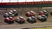 Dale Earnhardt Jr. (8) takes the lead on the final lap of the EA Sports 500. Earnhardt won the race on Sunday at Talladega Superspeedway in Talladega, Ala.
