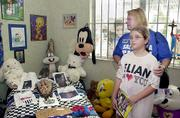 Deyanira Solis and her daughter Christable Garcia, 8, are overcome with emotion as they visit Elian Gonzalez's room at the home of his Miami relatives. Gifts, toys, clothes and photos from the time Elian was living in Miami fill the home, which was opened to the public on Sunday.