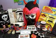 Spice up your Halloween look with false eyelashes, eyebrows and mustaches, flashy jewelry and sunglasses, vivid hair dye and funky legwear, shown here at Arizona Trading Co.