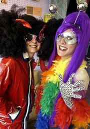 You don't have to be a ghoul or witch to fit in at Halloween costume parties. The staff at Arizona Trading Co., 734 Mass., has a host of clothes, wigs and accessories to create unlimited funky looks like these.