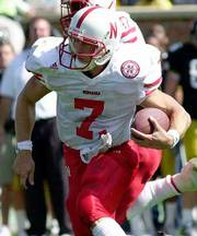 Nebraska quarterback Eric Crouch, above, and Oklahoma QB Jason White will collide in today's big game.