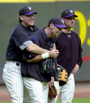 Arizona's Curt Schilling, left, clowns around with teammates Luis Gonzalez, center, and Tony Brohawn on Friday at Phoenix.