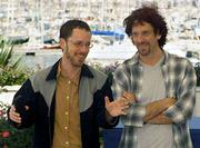 "Filmmakers Joel Coen, right, and his brother, Ethan Coen, appear for a photo session at the festival palace in Cannes, France. The siblings&squot; new movie, ""The Man Who Wasn&squot;t There,"" was directed by Joel and co-written by Ethan."