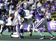 Kansas' Reggie Duncan is pulled down by a trio of K-State defenders. Duncan finished with 28 yards on 17 carries on Saturday at KSU Stadium.