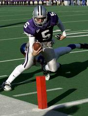 Kansas State QB Marc Dunn lunges for the goal line for a third-quarter touchdown.