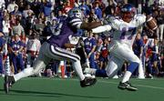 Kansas State's James Dunnigan, left, pressures Kansas quarterback Mario Kinsey. The Wildcats pounded the Jayhawks, 40-6, on Saturday at KSU Stadium, sending Kansas coach Terry Allen to his fifth straight loss with no wins in the Sunflower State Showdown.