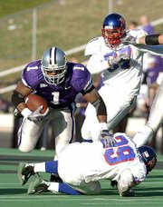 Kansas State's Josh Scobey (1) runs over Kansas' Jake Letourneau. Scobey finished with 204 yards on 28 carries in the Wildcats' 40-6 victory on Saturday at KSU Stadium.
