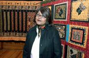 Marla Jackson shares her family's heritage through her narrative quilts. The quilts are on display at Watkins Community Museum of History through Dec. 14.