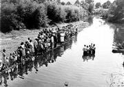 "marion Post Wolcott&squot;s ""Baptism of Members of Primitive Baptist Church in Triplett Creek, Roiwan County, Near Morehead, Kentucky"" 1940"