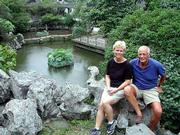 Barbara and J. Kristian Pueschel enjoy one of Suzhou's world-famous ancient gardens. Well laid out with pavilions, towers, kiosks, rocks, flowers and trees, they are serene oases combining nature, architecture and art.
