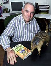"Bill Cannon shares tidbits about Texas history in his book ""Tales From Toadsuck Texas."" The book idea came when Cannon was recovering from surgery in a Dallas hospital, and another patient asked if he had heard of Toadsuck. He&squot;s shown here with his stuffed armadillo, Lil Tex."