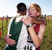 Lawrence High's Dylan McClain, right, the top city male finisher, is congratulated by Free State's Jason Jenny. McClain placed second at the Class 6A state cross country championship on Saturday at Rim Rock Farm.