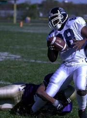 Lincoln University end Isaac Cooper gains good yardage Saturday against Haskell. The Indians fell, 56-16.