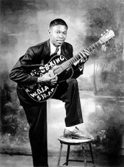 "A youngB.B. King is shown in this undated handout photo. ""American Roots Music,"" a four-part series on PBS, traces the development of uniquely American music genres, combining archival footage of King and others, along with newly filmed performances and interviews with artists and scholars."