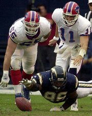 San Diego's Leonardo Carson (96) reaches out to recover a ball fumbled by Buffalo quarterback Rob Johnson (11) as the Bills' Jon Carman pursues during the first quarter. San Diego won, 27-24.