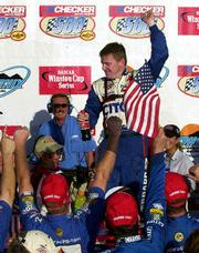 Jeff Burton celebrates his NASCAR Checker Auto Parts 500 win Sunday at Phoenix International Raceway in Avondale, Ariz.