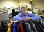 In a time when most online retail companies are going under, Smartbargains.com has had a significant increase in sales and business. Carl S. Rosendorf, the company's chief executive officer, is shown here with some of the site's offerings.