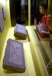 AKyle Sell, 10, of Atchison, looks at the tombstones of killers Richard Hickock and Perry Smith, while visiting the Kansas Museum of History in Topeka.