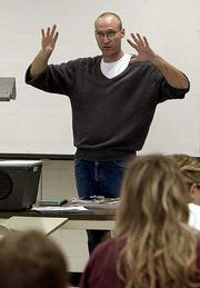 "Graduate teaching assistant Robert Vodicka discusses comparisons between the ""One Flew Over the Cuckoo&squot;s Nest"" novel and movie during his Western Civilization class titled ""Studies in Madness"" at Kansas University. Vodicka is lead negotiator for GTAC, which represents teaching assistants at KU."