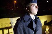 ROTC Cadet Jonathan Wright stands guard at the Vietnam Veterans Memorial at Kansas University. A 24-hour candlelight vigil began Thursday evening in memory of KU students and faculty who died in the Vietnam War. Cadets are rotating every hour at the vigil, done in conjunction with Veterans Day observances.