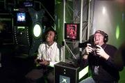 Microsoft's first foray into gaining -- the Xbox -- hits shelves Thursday. Mark Foxton, left, of San Jose, Calif., and Doug Kennedy of Twain Harte, Calif., right, play the video game DOA3 at the Xbox Odyssey in San Francisco.