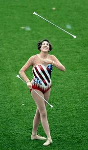 Angelea Busby, practices her baton twirling at Memorial Stadium. Busby is the first twirler the KU Marching Jayhawks have had in 15 years.