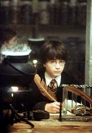 Harry Potter casts a magic spell.