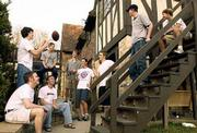 While other fraternities and sororities at Kansas University are seeing a slight climb or leveling in greek membership, the Theta Chi fraternity has experienced a tenfold increase in just three years. A group of Theta Chi brothers are shown outside their house, 1003 Emery Road, Friday afternoon.