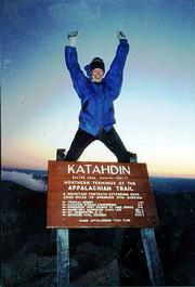 Leslie Scally throws her arms up in excitement at the end of her six-month trip hiking the entire 2,167-mile Appalachian Trail. The northern route of the trail ends at Mount Katahdin in Maine's Baxter State Park. Scally and a group of about 12 hikers started the final ascent at 2:30 a.m. in order to reach the peak just after sunrise. The group stayed at the peak for only 1 1/2 hours because of the 40-degree weather and 30 mph to 40 mph winds.