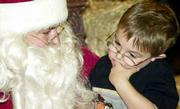 """Um I don&squot;t know,"" says 3-year-old Dylan Williams to Santa Claus regarding what the toddler wants for Christmas. Santa flew Friday from the North Pole to Lawrence to listen to children&squot;s wishlists."