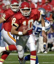 Chiefs quarterback Trent Green scrambles for a short gain. KC beat Seattle, 19-7, on Sunday in Kansas City.