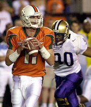 Miami quarterback Ken Dorsey (11) looks for an open receiver. The Hurricanes hammered Washington, 65-7, on Saturday to keep their national title hopes alive.