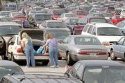Shoppers at the Orange Park Mall load their trunk with bags in a sea of parked cars in Orange Park, Fla. Consumers crowded malls and shopping centers over the Thanksgiving weekend, but sales were not quite as strong as merchants had hoped for.