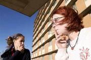 Kansas University is considering banning smoking at all residence halls. Smoking is already banned at three residence halls including Ellsworth Hall where Monday Alex Sanford, Wichita freshman, left, and Tanya Racke, Chicago, Ill., freshman, take their smoking outside.