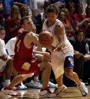 Kansas' Jeff Boschee, right, swipes the ball from Pitt State's Ryan Odaffer. Boschee had a career-best five steals in KU's rout of the Gorillas on Wednesday at Allen Fieldhouse.