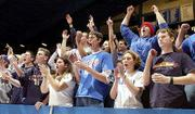KU STUDENTs celebrate a Jayhawk basket in the second half of Wednesday's game against Pittsburg State. A group of KU students is trying to get student seating in Allen Fieldhouse moved closer to the floor and team benches.