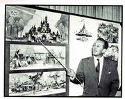 "Walt Disney points to sketches for his theme park during a scene from ""Walt Disney Treasures."""