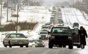 Drivers in Oklahoma City found the icy, snow-covered roads hard to deal with as a winter storm moved through the state. Temperatures hovered in the mid-20s Wednesday; two days ago, the temperature was in the 70s.
