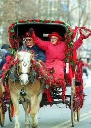 Bob and Diane Bernard of Fulton, Mo., show off during last year's Old Fashioned Christmas parade. This year's parade will begin at 11 a.m. Saturday on Massachusetts Street.