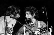 George Harrison, left, and Bob Dylan perform during a 1971 benefit concert at Madison Square Garden in New York.